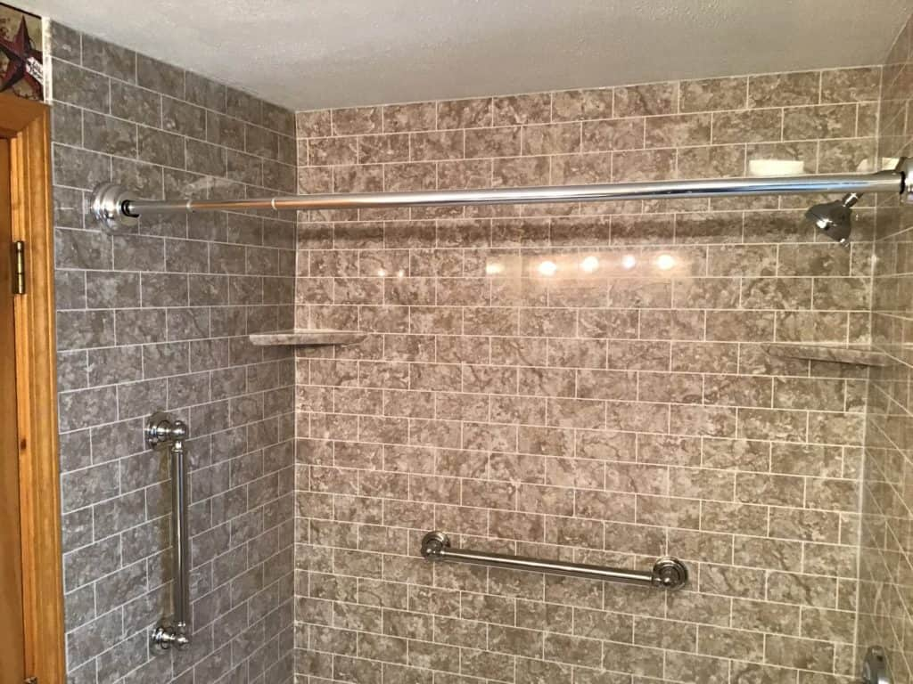 Clay Bathroom Remodeling with Travertine walls