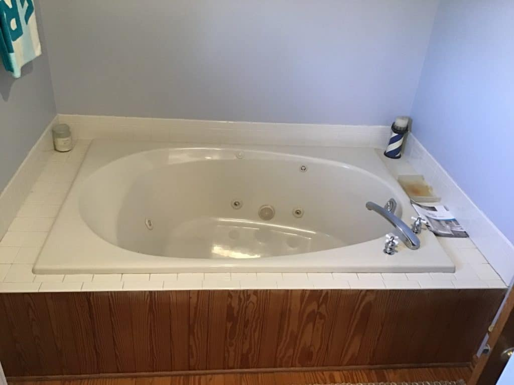 Before a bath tub to shower conversion with existing Jacuzzi