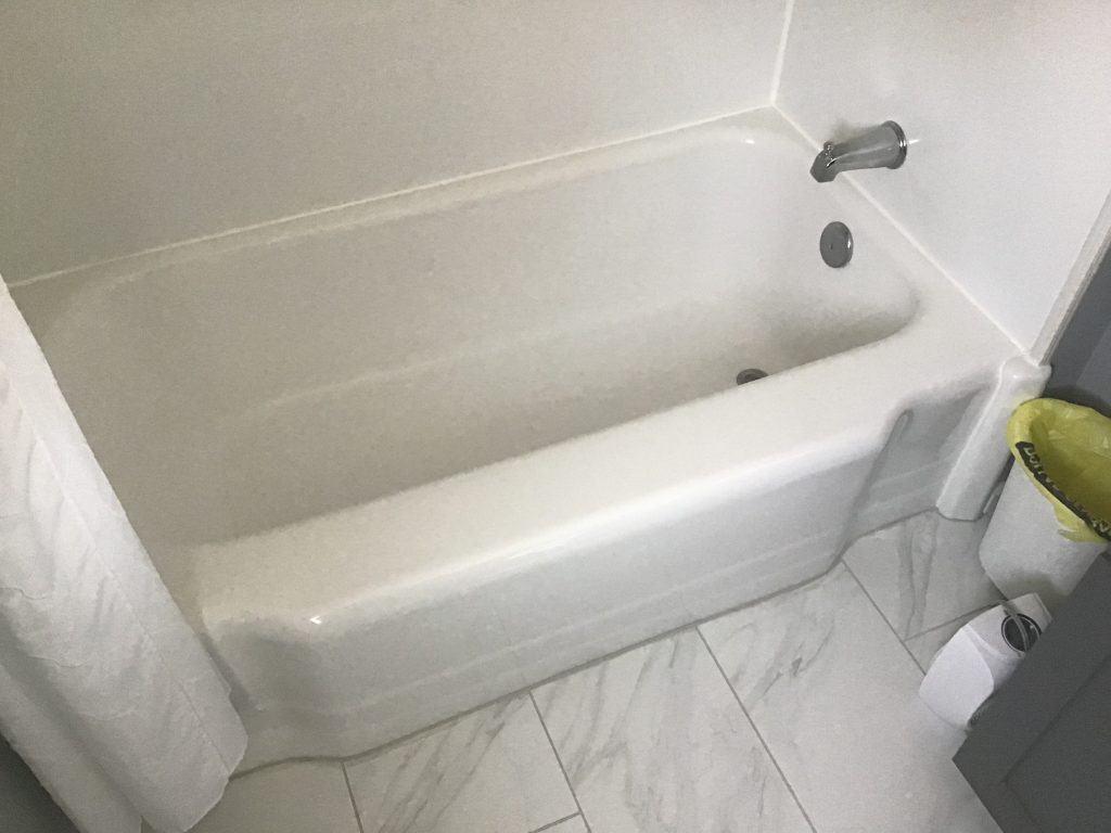 Before a fiberglass bath tub walls removal to shower conversion
