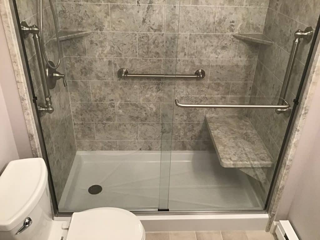 After a fiberglass bath tub removal to shower conversion